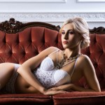 Sensual and beautiful young girl in a bridal lingerie on a retro