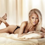 Beauty portrait of blonde woman lying and wearing lingerie.